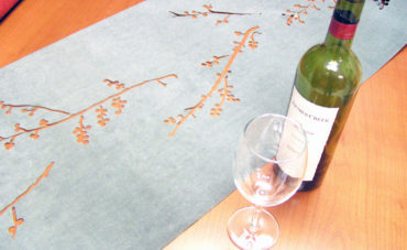 Laser cut textile table runners for Terrain